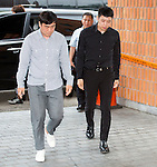 Yuchun (JYJ), Jun 30, 2016 : Yuchun (R), a member of K-pop boy band JYJ, appears at Gangnam Police Station to be questioned over sexual assault allegations in Seoul, South Korea. South Korean singer and actor Park Yuchun has been serving his military duty as a public agent now and he has been embroiled in a scandal as four women lodged complaints against him recently, insisting that they were raped by Yuchun, local media reported. (Photo by Lee Jae-Won/AFLO) (SOUTH KOREA)