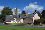 Great Britain, England, Suffolk, Cavendish: Thatched pink cottage and St Mary the Virgin church