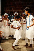Recife, Brazil. Candomble ceremony; girl beginning to go into a trance; Pernambuco State.