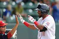 Third baseman Wendell Rijo (11) of the Greenville Drive in a game against the Asheville Tourists on Sunday, July 20, 2014, at Fluor Field at the West End in Greenville, South Carolina. Rijo is the No. 18 prospect of the Boston Red Sox, according to Baseball America. Asheville won game two of a doubleheader, 3-2. (Tom Priddy/Four Seam Images)