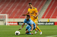 HARRISON, NJ - MARCH 11: Ismael Tajouri #29 of NYCFC is fouled by Jesus Duenas #29 of Tigres UANL during a game between Tigres UANL and NYCFC at Red Bull Arena on March 11, 2020 in Harrison, New Jersey.