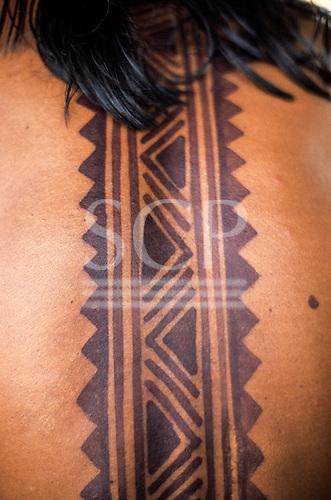 A-ukre village, Brazil. Megranoti-Kayapo body paint on a man's back; Xingu Indigenous Area, Para State.