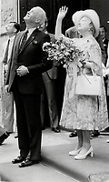 1987 FILE PHOTO - ARCHIVES -<br /> <br /> The Queen mother is escorted to here car by Hartland MacDougall national deputy chairman of the Duke of Edinburgh's awards in Canada.<br /> <br /> 1987<br /> <br /> PHOTO :  Erin Comb - Toronto Star Archives - AQP
