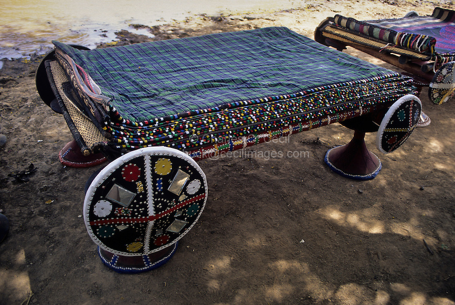 Akadaney, Central Niger, West Africa.  Fulani Nomads.  Portable Bed with Numerous Mats on Top.