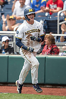 Michigan Wolverines outfielder Jesse Franklin (7) celebrates after scoring a run during Game 11 of the NCAA College World Series against the Texas Tech Red Raiders on June 21, 2019 at TD Ameritrade Park in Omaha, Nebraska. Michigan defeated Texas Tech 15-3 and is headed to the CWS Finals. (Andrew Woolley/Four Seam Images)