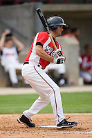 Mike Costanzo #4 of the Carolina Mudcats follows through on his swing against the Jacksonville Suns at Five County Stadium May 16, 2010, in Zebulon, North Carolina.  Photo by Brian Westerholt /  Seam Images