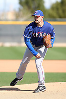 Mason Tobin #64 of the Texas Rangers participates in spring training workouts at the Rangers complex on February 21, 2011  in Surprise, Arizona. .Photo by:  Bill Mitchell/Four Seam Images.