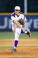 High Point Panthers starting pitcher John McGillicuddy (15) follows through on his delivery against the Coastal Carolina Chanticleers at Willard Stadium on March 14, 2014 in High Point, North Carolina.  The Panthers defeated the Chanticleers 3-0.  (Brian Westerholt/Four Seam Images)