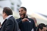 Ashley Williams yawning alongside Swansea City Football Club players and staff while celebrating their promotion to the Premier League with an opentop bus tour of the city, where thousands of supporters turned out to show their appreciation..