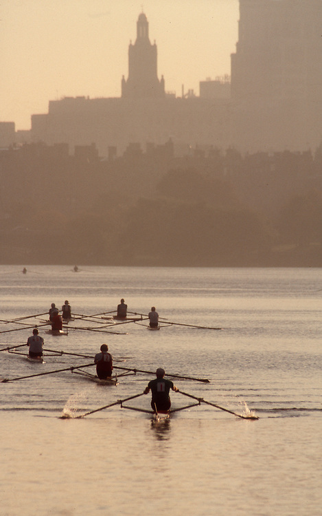 Rowing, Head of the Charles Regatta, Rowers in single racing shells at the start on the Charles River past  Boston's highrise buildings at dawn, Charles River, Boston, Massachusetts, New England, USA.