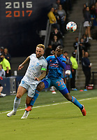 KANSAS CITY, KS - MAY 29: Johnny Russell #7 of Sporting KC and Boniek Garcia #27 of Houston Dynamo FC battle for the ball up the right wing during a game between Houston Dynamo and Sporting Kansas City at Children's Mercy Park on May 29, 2021 in Kansas City, Kansas.