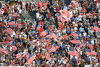 KANSAS CITY, KS - JULY 18: USA fans waving flags during a game between Canada and USMNT at Children's Mercy Park on July 18, 2021 in Kansas City, Kansas.