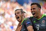Gareth Bale celebrates his first half goal for Wales with Hal Robson-Kanu at the Stade Bollaert-Delelis in Lens, France this afternoon during their Euro 2016 Group B fixture against England.