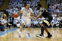 CHAPEL HILL, NC - MARCH 03: Cole Anthony #2 of the University of North Carolina is guarded by Chaundree Brown #23 of Wake Forest University during a game between Wake Forest and North Carolina at Dean E. Smith Center on March 03, 2020 in Chapel Hill, North Carolina.