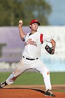 Ethan Miller #33 of the Salem-Keizer Volcanoes pitches against the Eugene Emeralds at Volcanoes Stadium on July 27, 2014 in Keizer, Oregon. Salem-Keizer defeated Eugene, 9-1. (Larry Goren/Four Seam Images)
