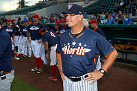 Tampa Yankees manager Jay Bell (9) looks on as his pitcher Andrew Schwaab (not shown) proposes to his girlfriend before the Florida State League All-Star Game on June 17, 2017 at Joker Marchant Stadium in Lakeland, Florida.  FSL North All-Stars defeated the FSL South All-Stars  5-2.  (Mike Janes/Four Seam Images)