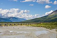 Trans Alaska oil pipeline crosses the delta river in the Alaska mountain range, Alaska.