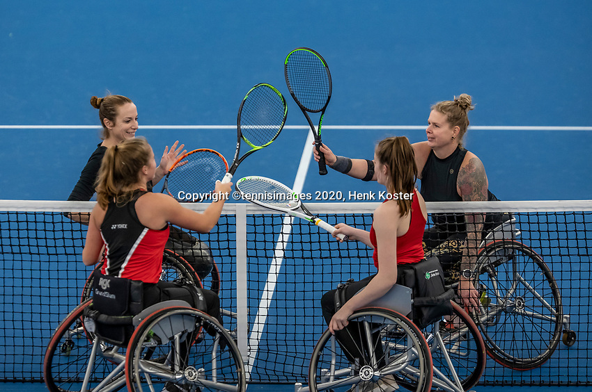 Amstelveen, Netherlands, 12  December, 2020, National Tennis Center, NTC, NKR, National   Indoor Wheelchair Tennis Championships, Women's Doubles Final :  Winners Jiske Griffioen (NED) and Michaela Spaanstra (NED) and runners up Jinte Bos (NED) and<br /> Lizzy de Greef (NED) (foreground)<br /> Photo: Henk Koster/tennisimages.com
