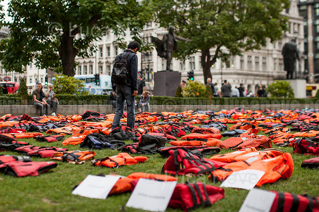 """London, 19/09/2016. Today, 2500 lifejackets were laid in London's Parliament Square to symbolize refugees and migrants who are crossings the Mediterranean to reach mainland Europe. The 2500 lifejackets (each lifejacket represents three deaths) come from the beaches of the Greek Island of Chios after they were worn by the people during the dangerous trip from Turkey. The demonstration coincided with the beginning of the United Nation summit on the worldwide Migrant Crisis. <<[…] The United Nations refugee body UNHCR, International Rescue Committee, Migrant Voice, World Vision, and Médecins Sans Frontières collaborated for the display, which they called a """"lifejacket graveyard"""" to illustrate the risks migrants take. The UNHCR estimates 6,940 people drowned or went missing while trying to reach Europe between January 2015 and August 2016 […]>> (Source – Reuters UK online at http://reut.rs/2d1XkBQ).<br /> <br /> For more information please click here: http://www.unhcr.org/refugeeday/"""