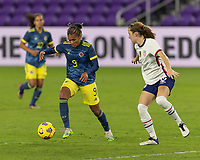 ORLANDO, FL - JANUARY 22: Kena Romero #9 dribbles away from Tierna Davidson #12 during a game between Colombia and USWNT at Exploria stadium on January 22, 2021 in Orlando, Florida.