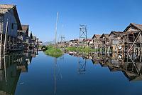 Myanmar, Burma.  Village Waterway, Houses on Stilts, Inle Lake, Shan State.