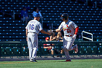 Surprise Saguaros catcher Andrew Knizner (96), of the St. Louis Cardinals organization, is congratulated by manager Spike Owen (16) after hitting his first home run of the game against the Mesa Solar Sox on October 20, 2017 at Sloan Park in Mesa, Arizona. The Solar Sox walked-off the Saguaros 7-6.  (Zachary Lucy/Four Seam Images)