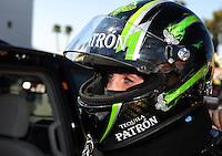 Feb. 17 2012; Chandler, AZ, USA; NHRA funny car driver Alexis DeJoria before making a run at the Arizona Nationals at Firebird International Raceway. Mandatory Credit: Mark J. Rebilas-