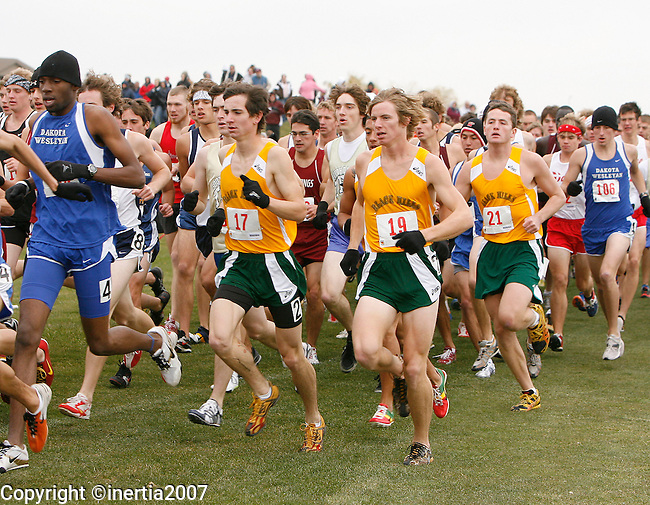 Runners from Black Hills State University make the first turn after the start of the men's NAIA Regional Cross County Meet at Prairie Green Golf Course in Sioux Falls Saturday morning, Nov. 3, 2007. Photo by Dick Carlson/Inertia.