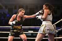 Chantelle Cameron (black shorts) defeats Anahi Ester Sanchez during a Boxing Show at York Hall on 9th November 2019
