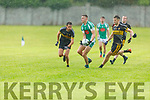 Na Gaeil's Diarmuid O'Connor been man marked by Kevin Fitzgerald and Sean McCarthy of Currow in the Intermediate Club Championship