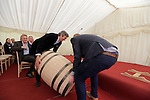 "The first cask for Slane Whiskey being rolled in at the ground breaking for the new $50 Million Slane Distillery on the grounds of Slane Castle.<br /> Picture Fran Caffrey /Newsfile.ie<br /> <br /> BROWN-FORMAN BREAKS GROUND ON<br /> NEW $50 MILLION SLANE DISTILLERY<br /> <br /> US Ambassador joins Conyngham and Brown families for historic occasion<br /> <br /> Distillery and Visitor Centre to be completed late 2016<br /> <br /> The US Ambassador to Ireland, Kevin F. O'Malley, was guest of honour today at the official ground breaking ceremony for the $50 million (approximately €44 million) Slane Distillery on the historic Slane Castle Estate in Co. Meath, home of Henry Conyngham, the eighth Marquess Conyngham, and his son Alex Conyngham, Earl of Mount Charles.<br />  <br /> The distillery, which will also include a Visitor Centre, is being built by leading US Drinks firm Brown-Forman Corporation, the owners of Jack Daniel's, Southern Comfort and Woodford Reserve which bought all shares of Slane Irish Whiskey Company from the Conyngham family earlier this year.  The Conynghams remain centrally involved in the development of the new distillery and the new whiskey brands which will be introduced in early 2017. <br />  <br /> This is the first new distillery Brown-Forman has built outside of the US and represents its entry into distilling Irish whiskey, one of the fastest growing spirits categories over the last few years.  When completed by the end of 2016, Slane Distillery will create nearly 25 new full-time jobs while the construction process will support approximately 80 jobs.  The Slane Distillery and Visitor Centre will be a welcome new attraction to the Boyne Valley tourism trail.<br />  <br /> The US Ambassador signed the first cask that will be filled with whiskey from the distillery and commented on the significance of the occasion, ""There are so many links between Ireland and the great state of Kentucky – people, music, horses and a great tradition of making the finest whiskies.  This is a truly modern linkage – combining the best in creativ"