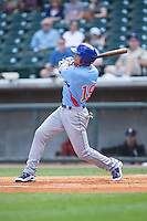 Jacob Hannemann (19) of the Tennessee Smokies follows through on his swing against the Birmingham Barons at Regions Field on May 3, 2015 in Birmingham, Alabama.  The Smokies defeated the Barons 3-0.  (Brian Westerholt/Four Seam Images)