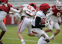 Arkansas running back Trelon Smith (22) carries the ball Saturday, April 3, 2021, during a scrimmage at Razorback Stadium in Fayetteville. Visit nwaonline.com/210404Daily/ for today's photo gallery. <br /> (NWA Democrat-Gazette/Andy Shupe)