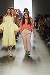 Graduating design student Sara Teator, walks runway with model at the close of 2017 Pratt fashion show on May 4, 2017 at Spring Studios in New York City.