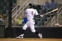 Tyler Sullivan (5) of the Kannapolis Intimidators follows through on his swing against the Hickory Crawdads at Kannapolis Intimidators Stadium on April 9, 2016 in Kannapolis, North Carolina.  The Crawdads defeated the Intimidators 6-1 in 10 innings.  (Brian Westerholt/Four Seam Images)