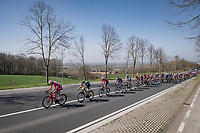 peloton stayed locked for a very long time into the race <br /> <br /> 76th Dwars door Vlaanderen 2021 (MEN1.UWT)<br /> 1 day race from Roeselare to Waregem (184km)<br /> <br /> ©kramon