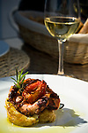 Octopus, tomato and potatoes at a restaurant in Pedralava in the Algarve region of Portugal.