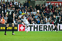 Thursday  03 October  2013  Pictured:Wayne Routledge of Swansea crosses the ball <br /> Re:UEFA Europa League, Swansea City FC vs FC St.Gallen,  at the Liberty Staduim Swansea