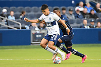 KANSAS CITY, KS - MAY 16: Ryan Raposo #27 Vancouver Whitecaps with the ball during a game between Vancouver Whitecaps and Sporting Kansas City at Children's Mercy Park on May 16, 2021 in Kansas City, Kansas.