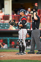 Richmond Flying Squirrels catcher Eliezer Zambrano (2) and umpire Randy Rosenberg during a game against the Erie SeaWolves on May 27, 2016 at Jerry Uht Park in Erie, Pennsylvania.  Richmond defeated Erie 7-6.  (Mike Janes/Four Seam Images)