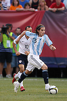 Argentina midfielder Fernando Gago (5) and United States forward Landon Donovan (10). The men's national teams of the United States and Argentina played to a 0-0 tie during an international friendly at Giants Stadium in East Rutherford, NJ, on June 8, 2008.