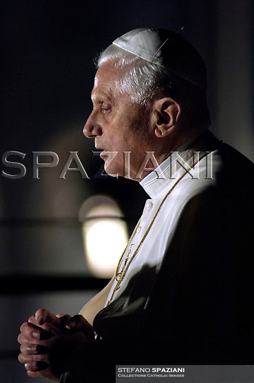 Pope Benedict XVI holds the wooden cross during the Via Crucis (Way of the Cross) torchlight procession on Good Friday in front of the Colosseum in Rome, Friday,April 6, 2007.The evening Via Crucis procession at the ancient Colosseum amphitheater is a Rome tradition that draws a large crowd of faithful, including many of the pilgrims who flock to the Italian capital for Holy Week ceremonies before Easter SundayVia Crucis;