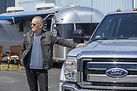 BNPS.co.uk (01202 558833)<br /> Pic: PawelLitwinski/Bonhams/BNPS<br /> <br /> Pictured: Tom Hanks with the 2011 Ford F450 Super Duty Crew Cab Lariat Pickup<br /> <br /> The airstream trailer superstar Tom Hanks used on film sets for over 30 years has sold for £170,000.<br /> <br /> The award-winning actor bought and personally equipped the trailer in 1993 and made it his 'home away from home' on 18 different movie sets across America.<br /> <br /> The Hollywood star decided to put his 1992 Airstream up for auction at Bonhams in LA, along with the Ford pickup he used to tow it, his high-performance Tesla Model S and a 1980 Toyota Land Cruiser.<br /> <br /> In total the vehicles sold for £368,577.