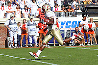 Oct 2, 2010; Charlottesville, VA, USA; Florida State Seminoles running back Chris Thompson (23) runs for a 14 yard touchdown during the 2nd half of the game against the Virginia Cavaliers at Scott Stadium. Florida State won 34-14. Photo/The Daily Progress/Andrew Shurtleff