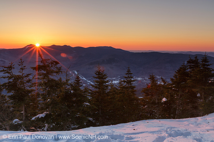 Sunrise over mountain tops from Mt Tecumseh in Waterville Valley, New Hampshire during the spring months. View shedding (illegal cutting) has improved the summit view.