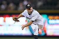 Charlotte Knights starting pitcher Kyle Kubat (19) follows through on his delivery against the Scranton/Wilkes-Barre RailRiders at BB&T BallPark on August 13, 2019 in Charlotte, North Carolina. The Knights defeated the RailRiders 15-1. (Brian Westerholt/Four Seam Images)