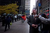 """New York, New York<br /> November 15, 2011<br /> <br /> The morning after police evicted Zuccotti Park of """"Occupy Wall Street"""" protesters the sidewalk on Broadway is clear for the first time in two months.<br /> <br /> The protesters then marched to Juan Pablo Duarte Square at Canal and 6th Ave and final back to Zuccotti Park to wait a court order to reenter the park."""