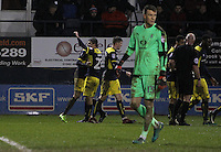 Oxford United players celebrate after Pelly-Ruddock Mpanzu of Luton Town scores a own goal and their second as Matt Macey of Luton Town looks on during the The Checkatrade Trophy Semi Final match between Luton Town and Oxford United at Kenilworth Road, Luton, England on 1 March 2017. Photo by Stewart  Wright  / PRiME Media Images.