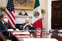 United States President Joe Biden, flanked by US Secretary of State Antony Blinken, left, listens during a virtual bilateral meeting with President Andrés Manuel López Obrador of Mexico in the Roosevelt Room of the White House in Washington on March 1st, 2021. <br /> Credit: Anna Moneymaker / Pool via CNP /MediaPunch