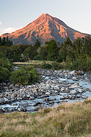 Sunrise over Waiwhakaiho River and Taranaki, Mt. Egmont in background, Egmont National Park, North Island, New Zealand, NZ
